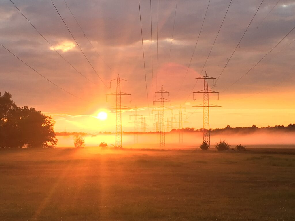 low angle photography of electric post near fogs